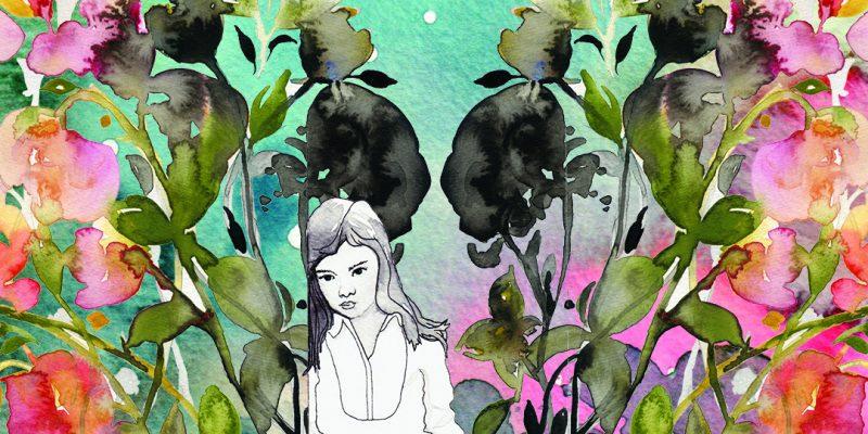 Girl sitting alone in a flower garden