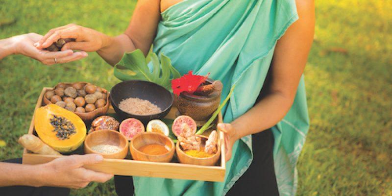 Jeana Naluai holding tray of food