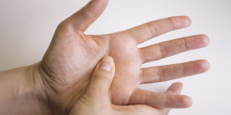 Hands illustrate the self-massage of Jin Shin Jyutsu