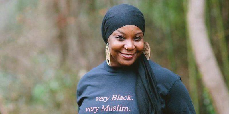 """Kameelah Rashad wearing a shirt that says """"Very Black, Very Muslim"""""""
