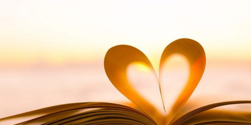Book heart with sunset