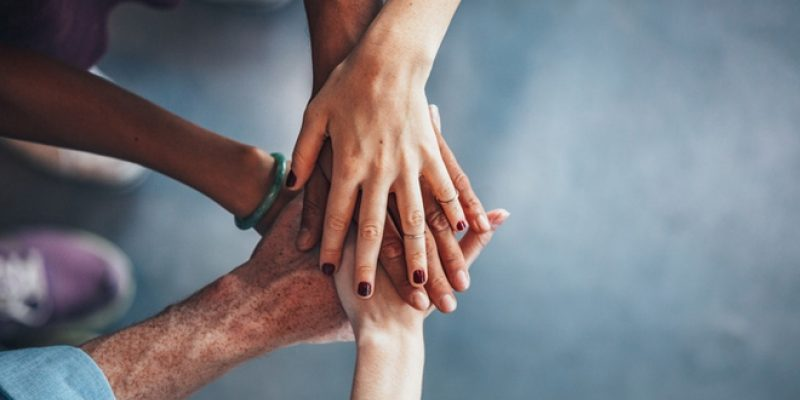 diverse hands in circle