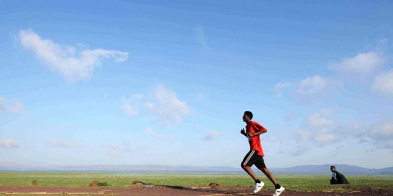 Man running with clear blue sky
