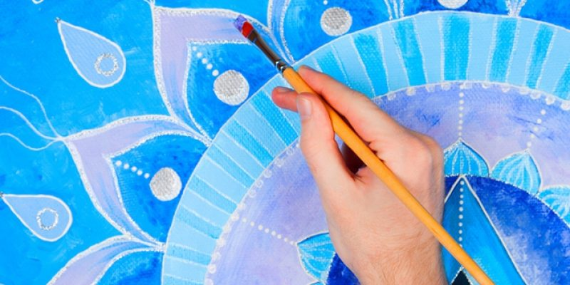 Painting a blue mandala design