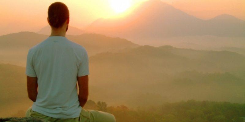 Man meditating at Sunset
