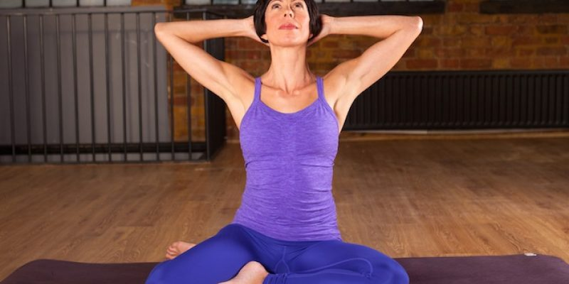 Woman doing yoga pose for neck pain