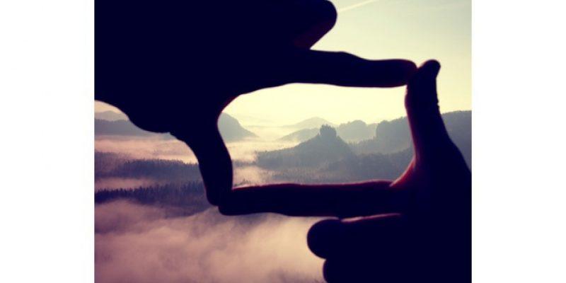 Hands framing beautiful scene