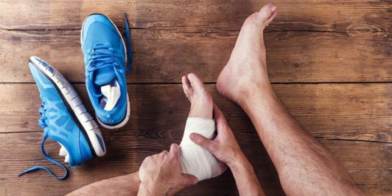 Man massaging sore ankle
