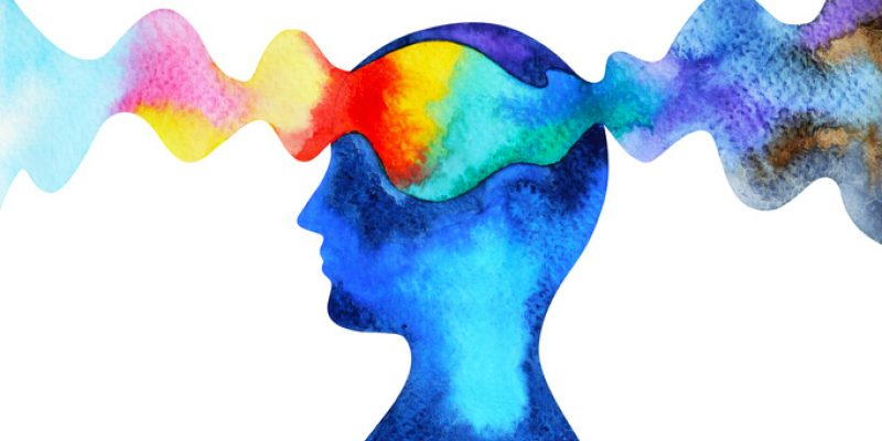 A wave of color passes through a person's mind showing spirituality and anxiety