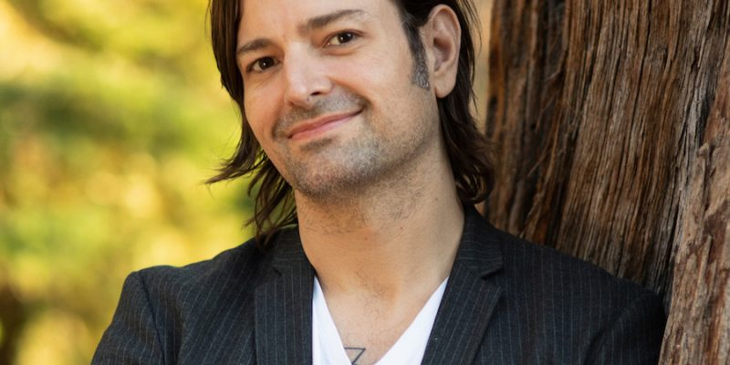 Ralph De La Rosa, author of Don't Tell Me To Relax