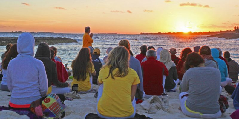 Retreat participants on beach at Sivananda Ashram Yoga Retreat Bahamas