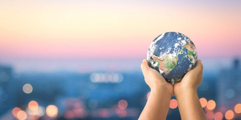 Hands holding planet Earth