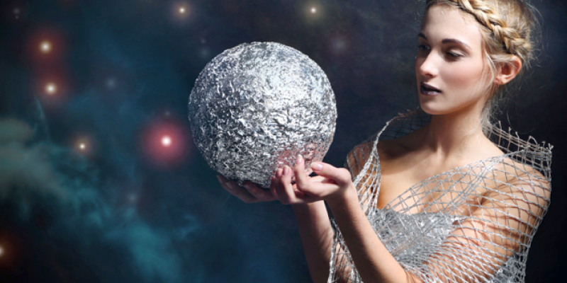 Woman holding silver orb
