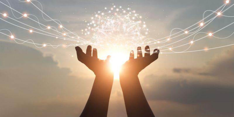 Hands holding a ball of light