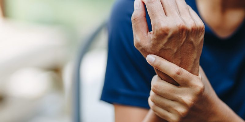 Woman holding sprained wrist