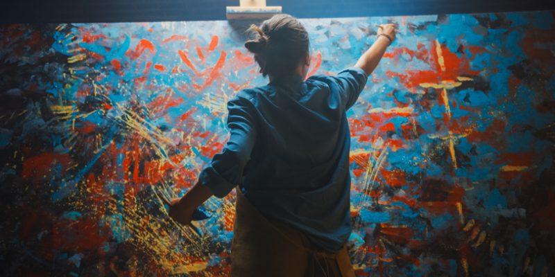 female artist creating painting art and spirituality