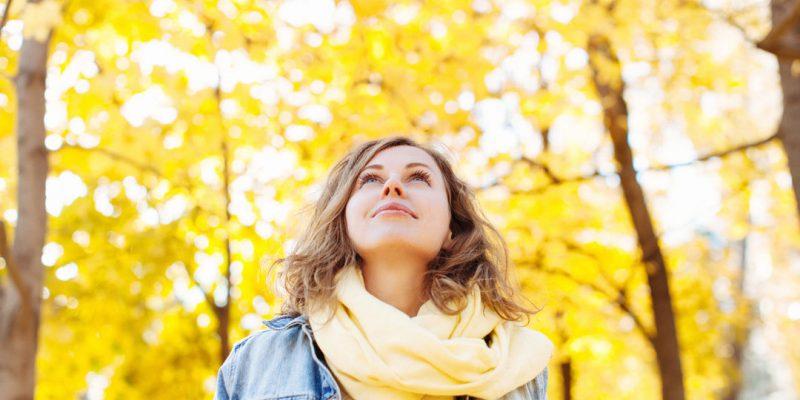 Woman enjoying fall trees