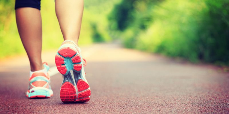 A woman walks in exercise gear.