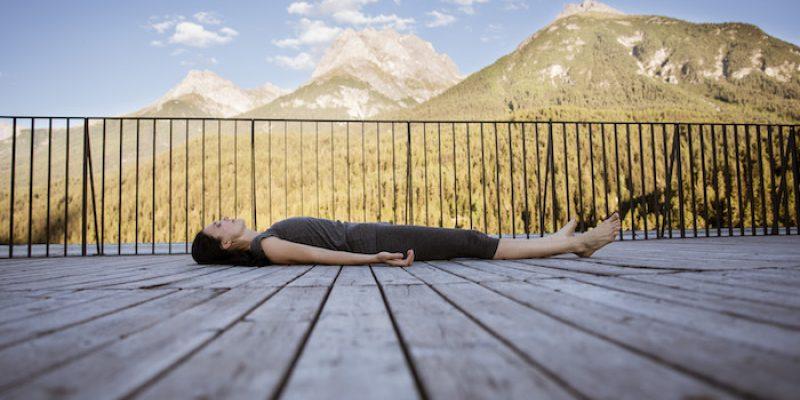 Elena Mironov laying in corpse pose during yoga nidra meditaton