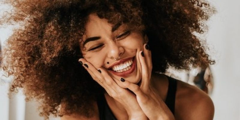 Woman with big smile shows emotional resilience