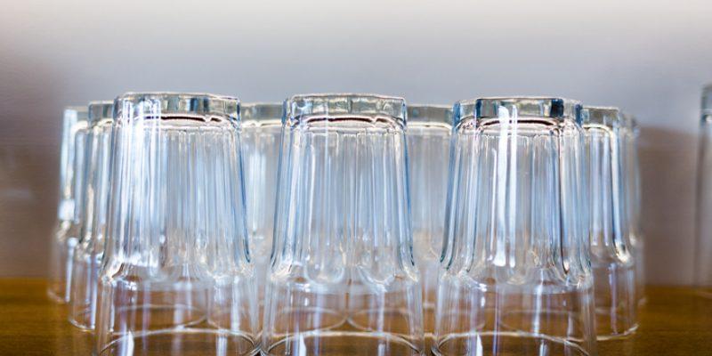 empty glasses on a shelf