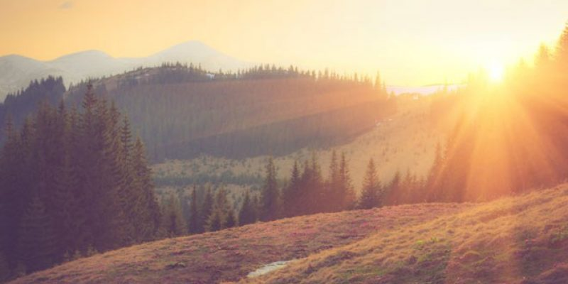 Sun breaks over a beautiful mountain scene