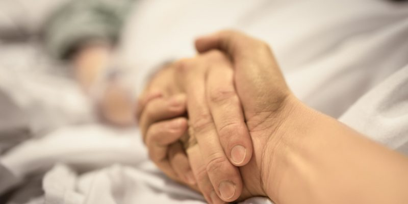 holding persons hand in hospital final words
