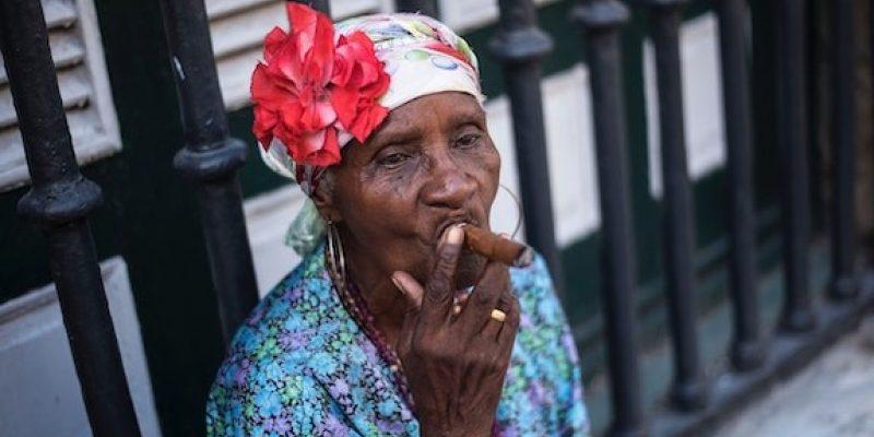 Woman smoking cigar hoodoo meaning