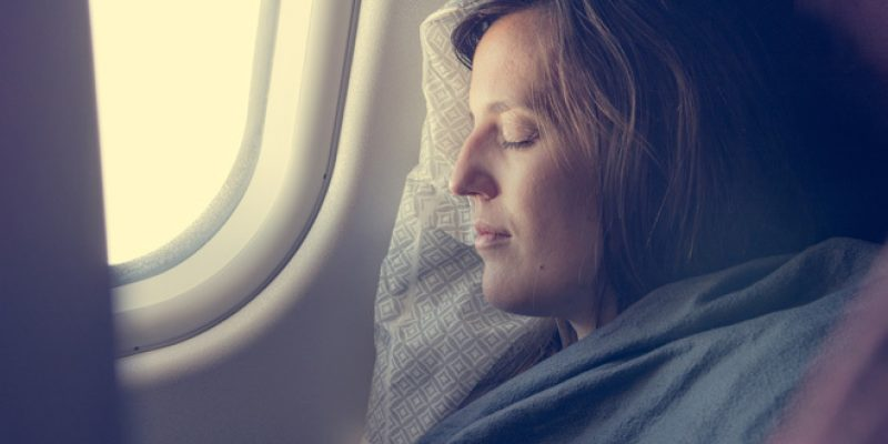 woman sleeping on plane