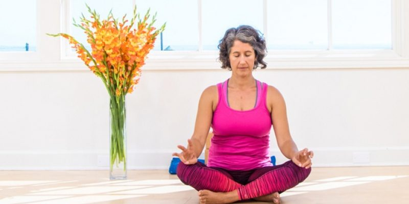 Image of Kira Sloane in meditation