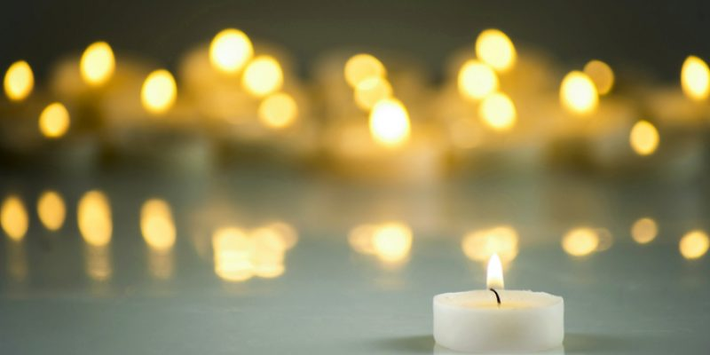 Lit candle in candlelight vigil