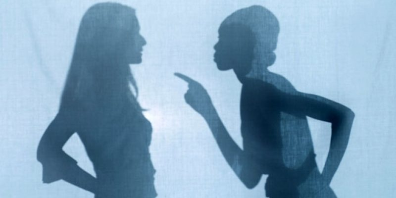 Silhouettes of women in argument
