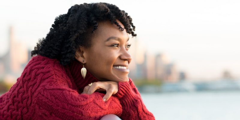 woman looking out happy