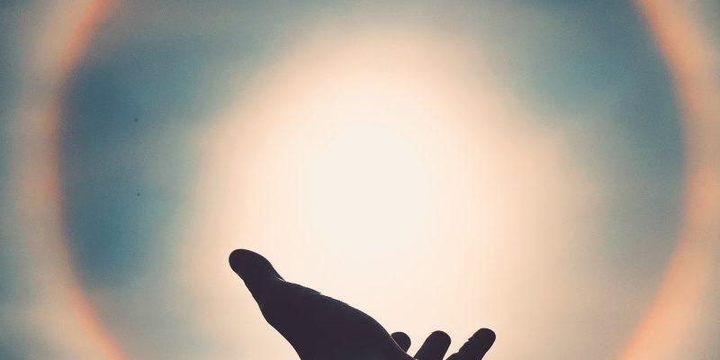 spiritual alchemist hand reaching for spiritual light