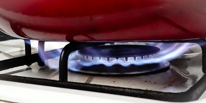 """<img src=""""stove.jpg"""" alt=""""a flame under a red pan on stove""""/>"""