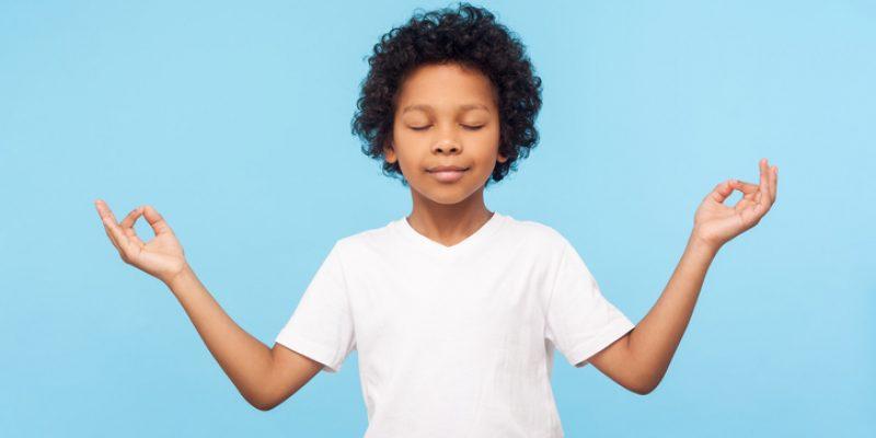 Teaching mindfulness to kids boy in meditation