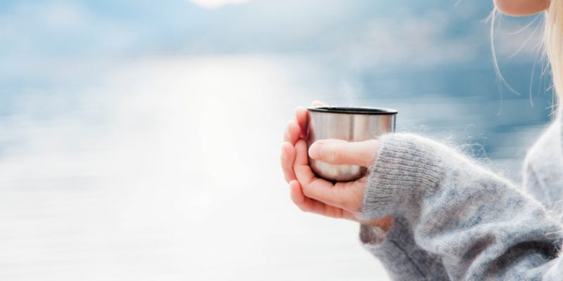 woman with cup benefits of drinking warm water
