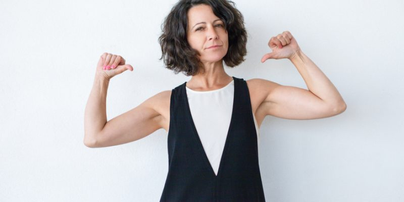 woman pointing to self dependable strength