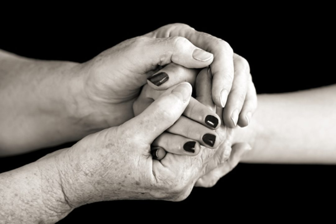 Two hands in black and white