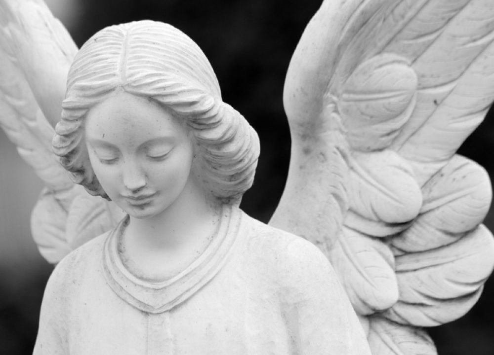 close up of winged angel statue, Italy