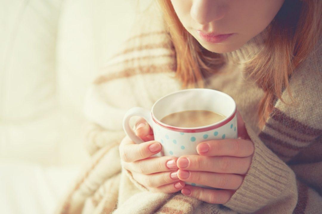 Girl with warm tea