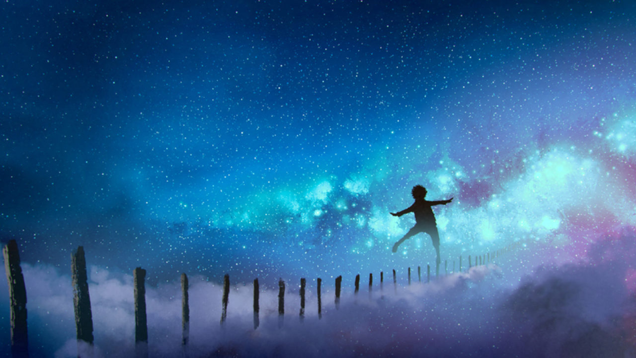 Boy balancing on sticks a starry night