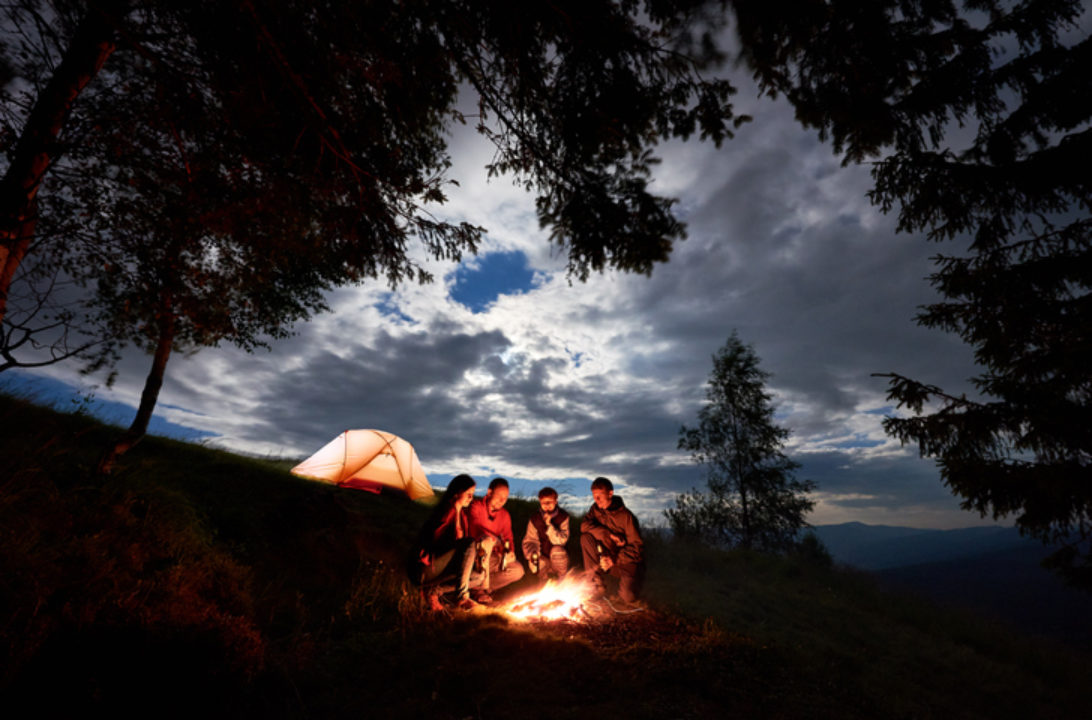 people gathered around a campfire