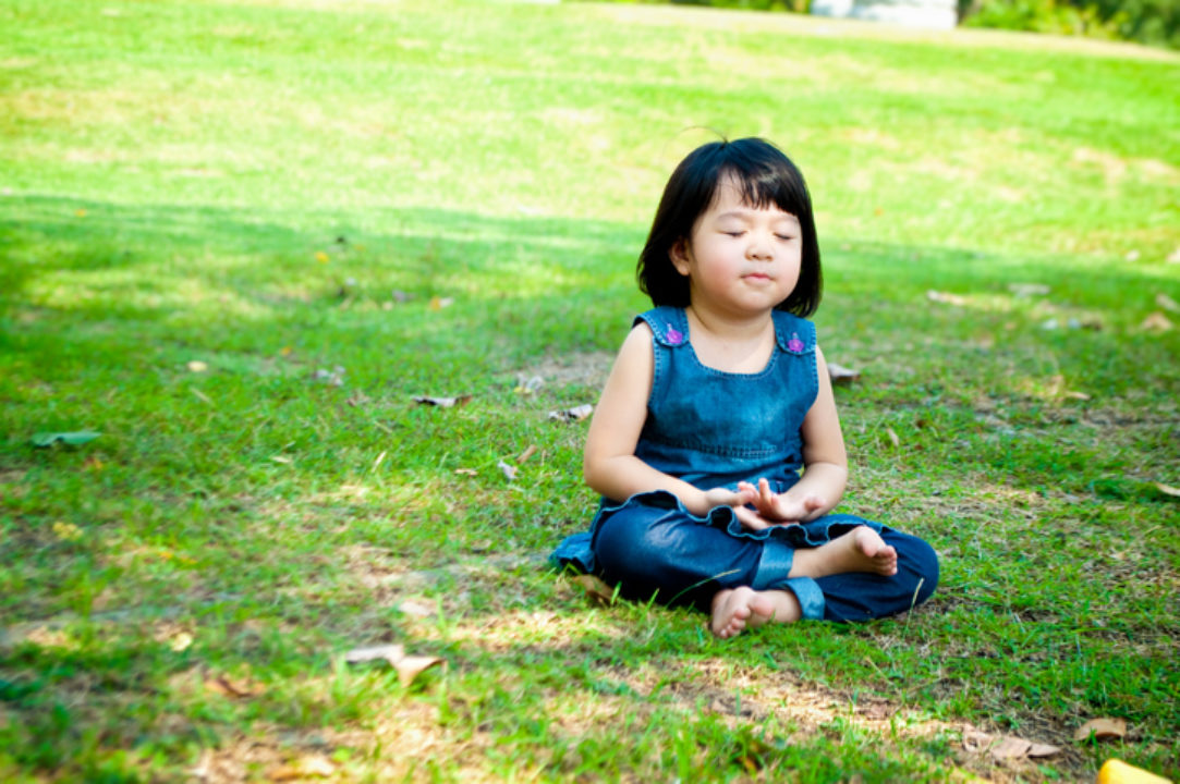 A child practices mindfulness