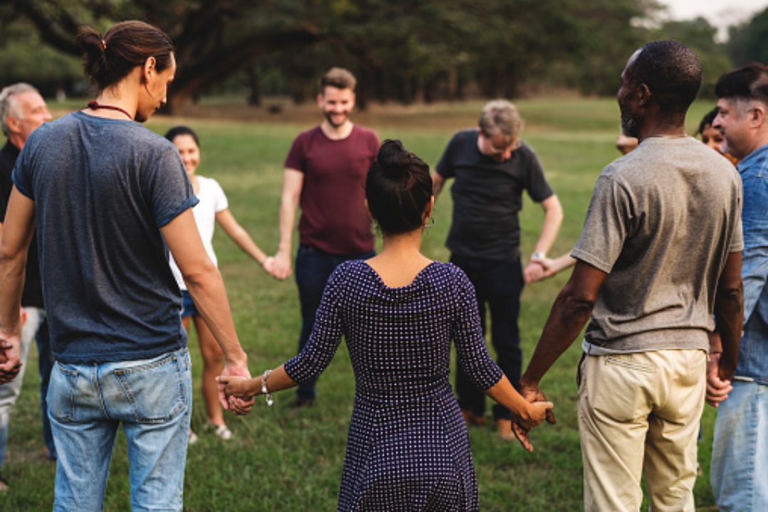 Circle of people holding hands