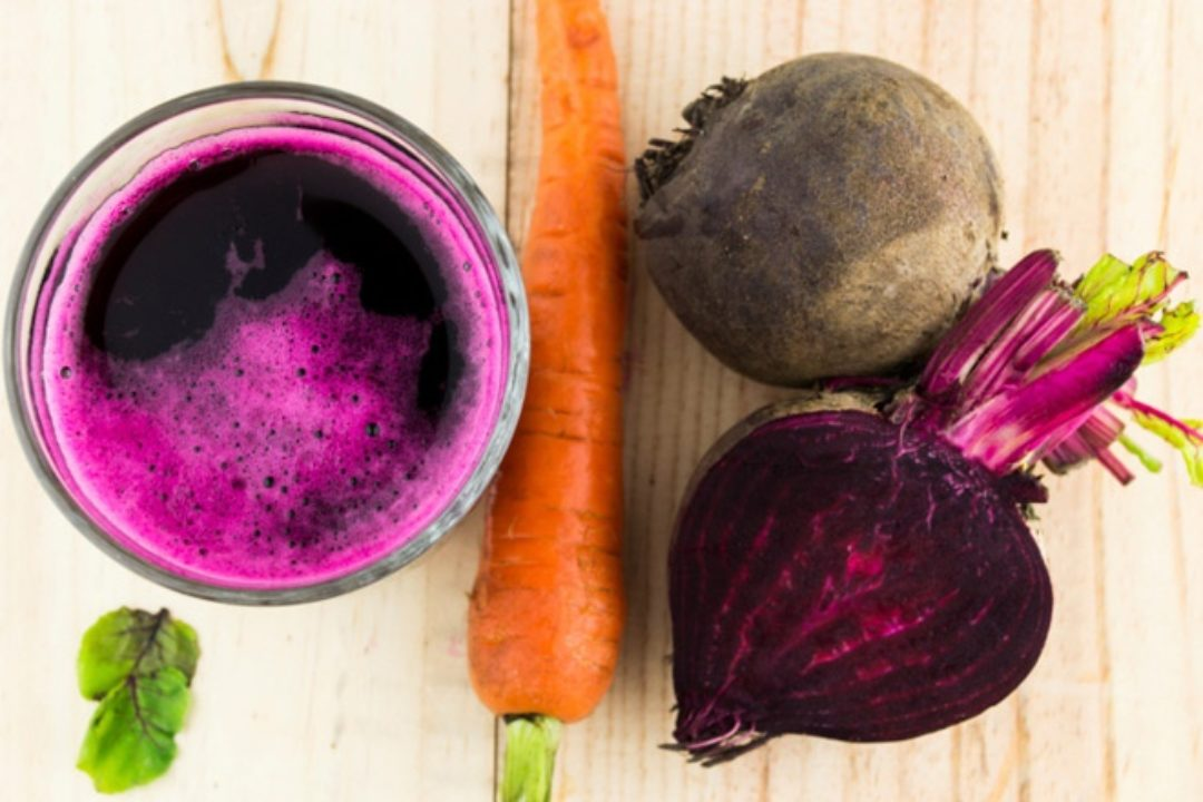 Beet carrots and juice on wood surface