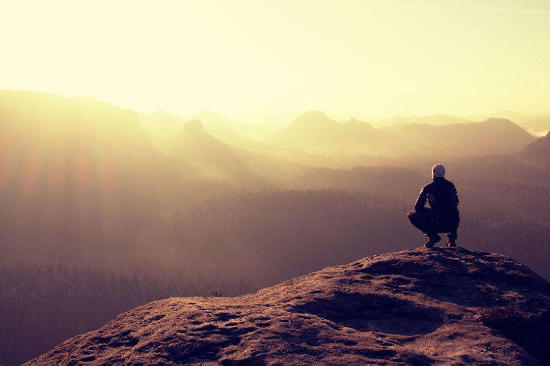 Man looking over horizon