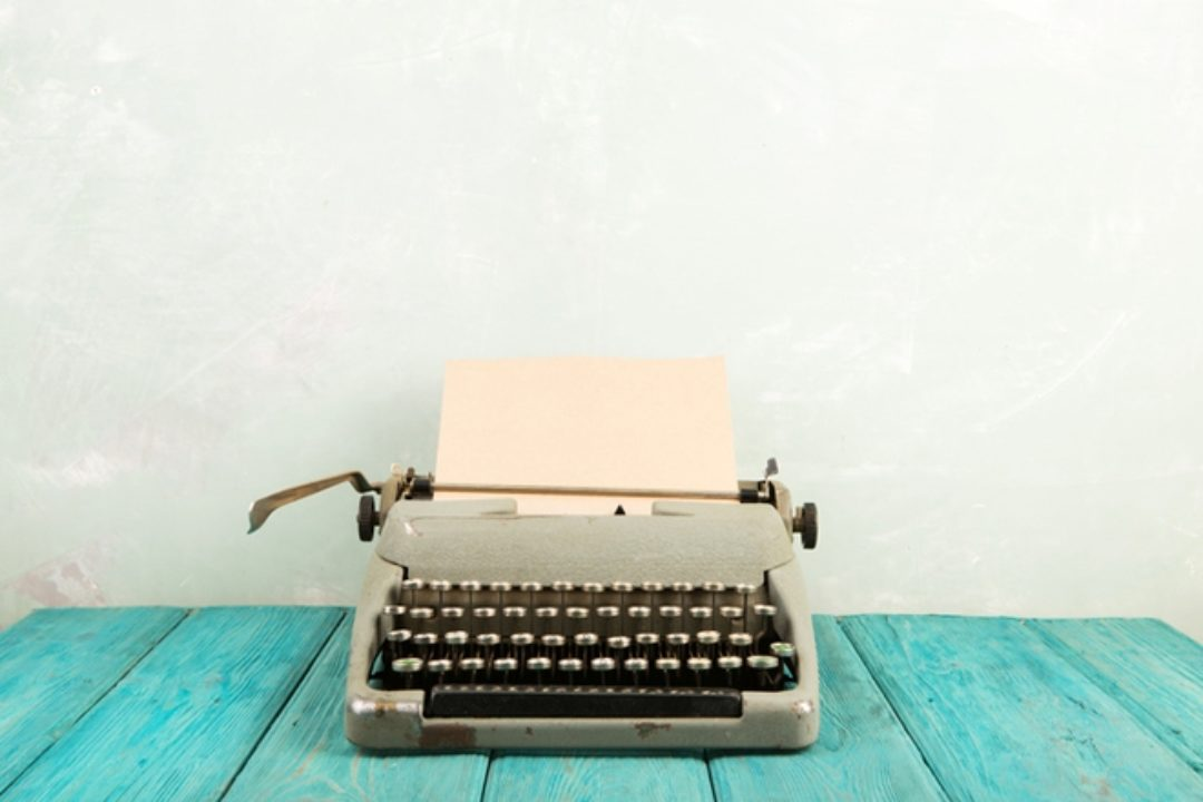Typewriter on blue table