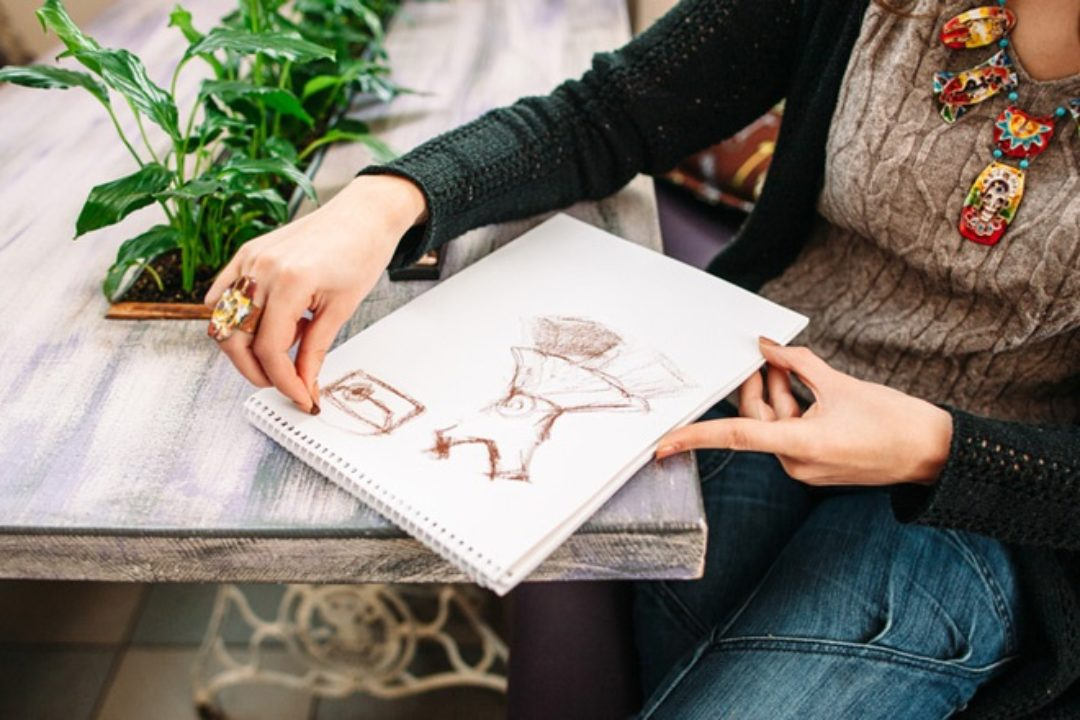 Woman drawing on wood table