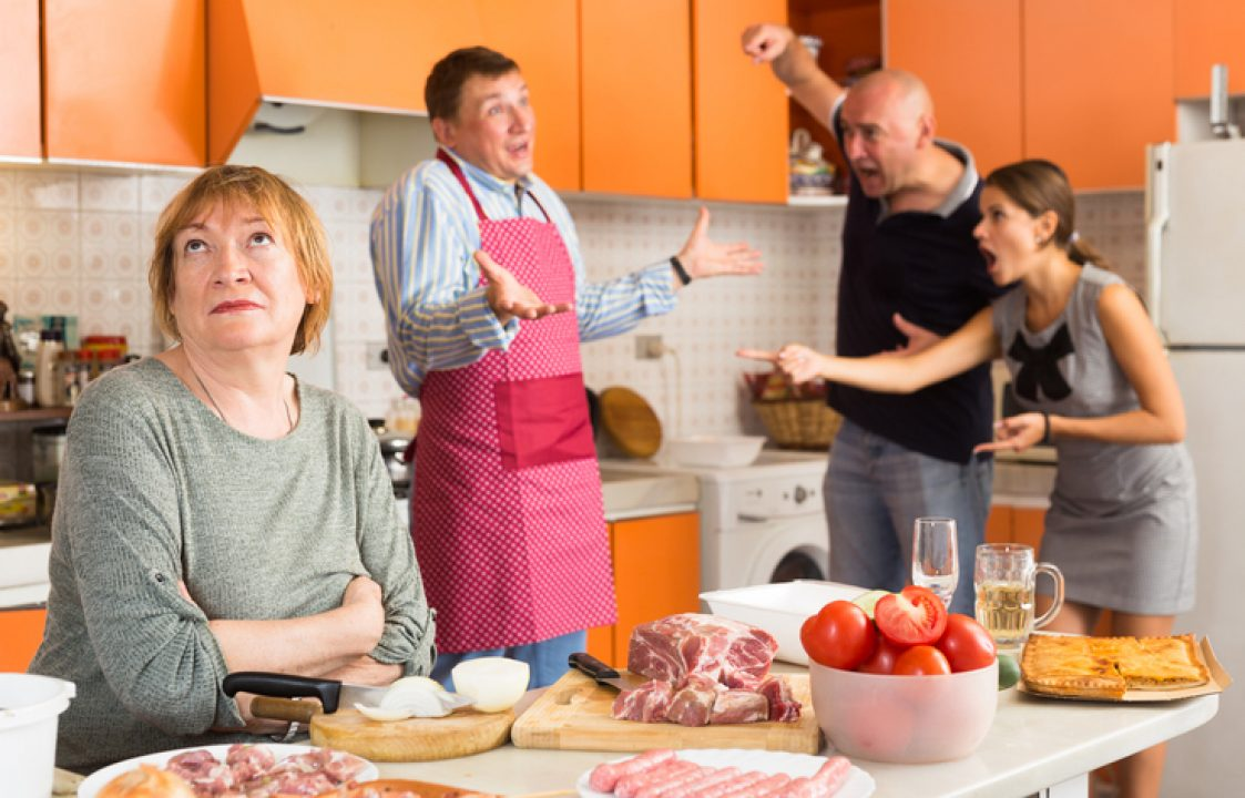 Upset mother with her family fighting and not getting along